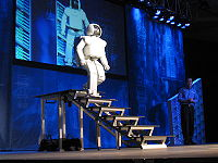 ASIMO uses sensors and intelligent algorithms to avoid obstacles and navigate stairs.