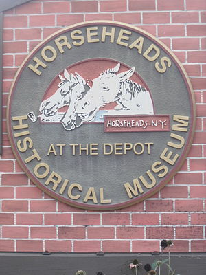 Eugene Zimmerman - This sign, found at the Chemung Railway Depot-Horseheads features a visual caricature of Horseheads's name