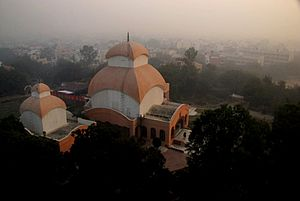 Chittaranjan Park Kali Mandir - Chittaranjan Park Kali Mandir at sunrise.  The entrance to the main kali temple can be seen at center. The bengali-majority colony of Chittaranjan Park in the background.