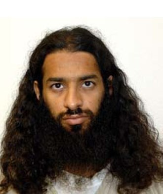 Mahmoud Omar Mohammed Bin Atef - Mahmud Omar Ben Atif's official Guantanamo identity portrait, showing him wearing the white uniform issued to compliant individuals.