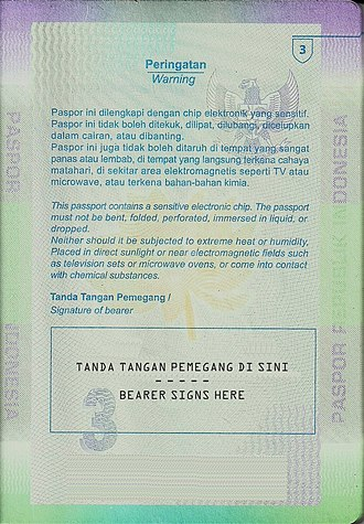 Indonesian passport - E-passport: Contains bearer's signature and a notice regarding the embedded biometric chip