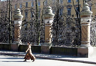 Guard rail - A cast iron grille of decorative railings interspersed by weighty columns in St Petersburg