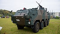 JGSDF NBC reconnaissance vehicle(81-9511) left front view at Camp Shinodayama April 20, 2014 04.jpg