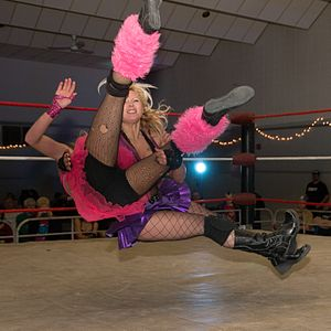 Powerslam - Jewells Malone performs a sidewalk slam on Beautiful Beaa (pink).