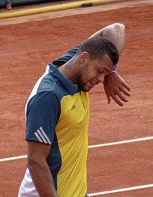 Tsonga wiping his face with his wristband.
