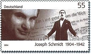 Joseph Schmidt - Stamp commemorating the birth of Joseph Schmidt (Deutsche Post 2004). The musical score shows the title of his 1933 film Ein Lied geht um die Welt (A song goes round the world)