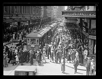 Sydney central business district - A tram passes through a crowd of people during lunch hour, Pitt Street, 1937.