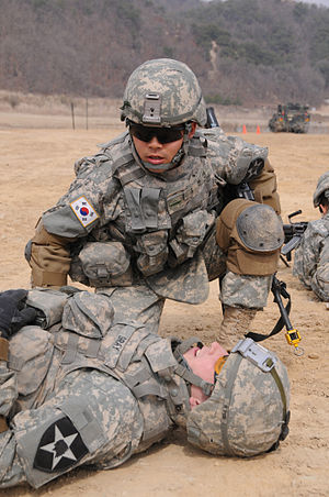 Korean Augmentation To the United States Army - KATUSA soldier assigned to 2nd Battalion, 9th Infantry Regiment, 1st Heavy Brigade Combat Team, 2nd Infantry Division wearing the U.S. Army's battle dress uniform, the Army Combat Uniform