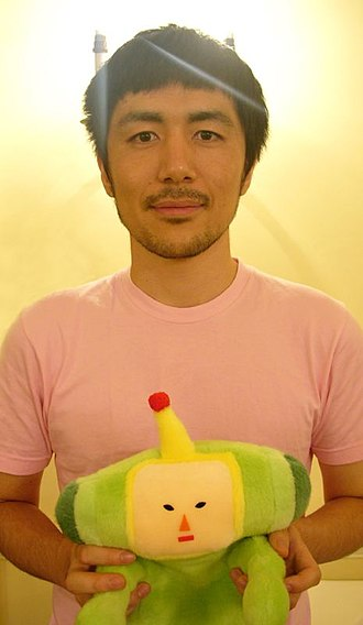 Keita Takahashi - Takahashi holding the Prince character from Katamari Damacy, at GDCE, London, in 2005