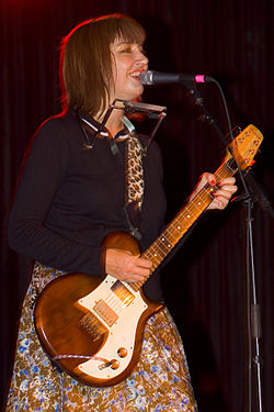 Kim-Shattuck-guitar-singing.jpg