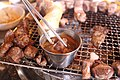 Korean barbecue - dipping grilled pork shoulder in meljeot.jpg