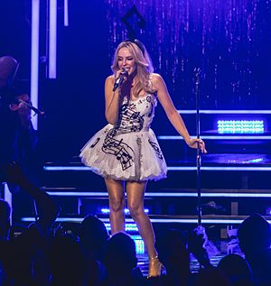Every Day's Like Christmas - Minogue performing the song during one of her Kylie Christmas concerts, in 2015.