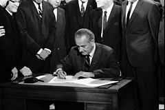 LBJ signing Civil Rights Act of 1968 ppmsca.03196.jpg