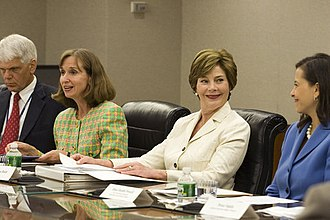 Dina Powell - First Lady Laura Bush talking to Assistant Secretary Powell during the fifth meeting of the U.S. Afghan Women's Council at the State Department, July 2006, in Washington, D.C.