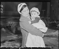 Los Angeles, California. Evacuee mother and child ready to board a train which will take them to an . . . - NARA - 536772.tif