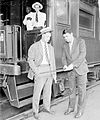 Lou Gehrig and Babe Ruth,New York Yankees, standing in front of a passenger train car in a railroad station.jpg