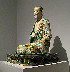 Yixian glazed pottery luohans - The older of the New York figures, from the side