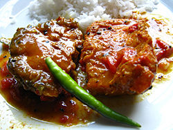 Bengali cuisine wikipedia a traditional bengali fish meal rice with macher jhol literally translated to fishs gravy forumfinder Gallery
