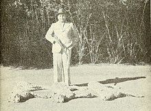 Maharaja Ramanuj Pratap Singh Deo standing beside the bodies of the last three wild cheetahs in India