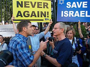 Two men arguing politics outside Iranian Presi...