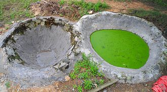 Manure - Cement reservoirs, one new, and one containing cow manure mixed with water. This is common in rural Hainan Province, China.