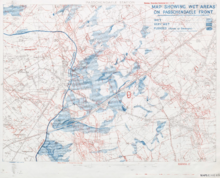 a topographical map with blue and red lines overprinted showing the location of trench lines. The map is supplemented to blobs or blue close to the British front line showing areas that are waterlogged.