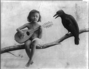 Little nude black girl with mandolin, sitting ...