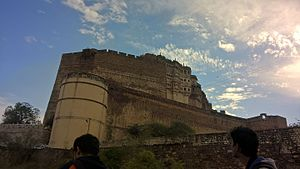 Mehrangarh - The imposing silhouette of the Mehrangarh fort against the stunning clouds at Jodhpur.