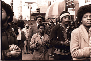 Jim Jones - Peoples Temple members attend an anti-eviction rally at the International Hotel, San Francisco, January 1977.