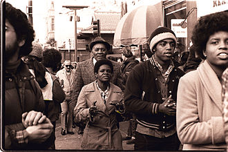Peoples Temple - People's Temple members attend an anti-eviction rally at the International Hotel, San Francisco, January 1977.