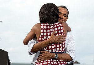Barack Obama on social media - Barack Obama embraces the First Lady after she had introduced him at a 2012 election campaign event in Davenport, Iowa. The campaign tweeted a similar photograph from the campaign photographer on election night and many people thought it was taken on election day.