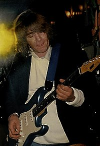 Mick Taylor-and guitar.jpg