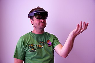 Augmented reality - A Microsoft HoloLens being worn by a man