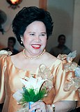 Miriam beams as she attends a wedding as a sponsor.JPG