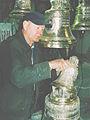 Moldovan bell master Yuri Ivanovich carving a bell (90-ies). (6225718486).jpg