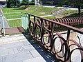 Most, kovové zábradlí u 2. náměstí a hlavní pošty.jpg