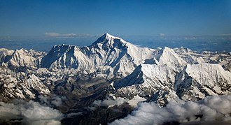 Mount Everest - Aerial photo from the south, with Mount Everest rising above the ridge connecting Nuptse and Lhotse