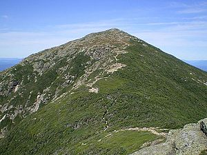Mount Lafayette - Mount Lafayette as viewed from Franconia Ridge. Hikers are visible hiking through the krummholz in the col.