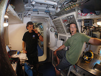 Andrew Abercromby - Abercromby and Aquarius habitat technician Nate Bender performing communication checks during NEEMO 14 mission.
