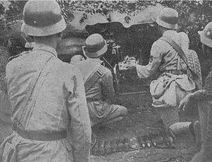 3.7 cm Pak 36 - Stahlhelm-wearing Chinese soldiers deploying a Pak 36.