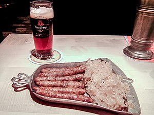 Sausage - Cooked Nuremberger pork sausages, sauerkraut and beer in Germany