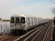 An A train is about to enter the Broad Channel station.