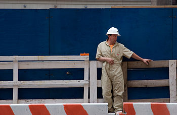 English: Construction worker resting in a brea...