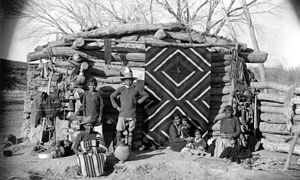 Navajo weaving - Navajo winter hogan with blanket used as a door, 1880-1910