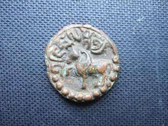 Licchavi (kingdom) - Copper coin of Jishnu Gupta (c. 622-633) of the Nepalese Licchhavi Dynasty. Obverse. The inscription above the winged horse is Sri Jishnu Guptasya