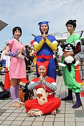 Four people in costume