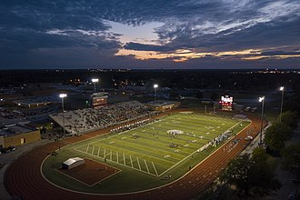 Norman High School - Norman High School football field and track. The Norman Tigers are playing the Edmond Santa Fe Wolves on Homecoming Friday 2017, September 29. Left in the background is Norman High School.
