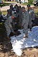 North Dakota National Guard soldiers with the 817th Engineer Company build sandbag levee.jpg