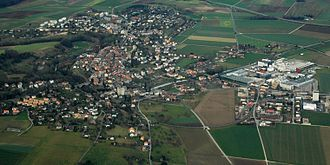 Orbe - Aerial view of Orbe, showing the tree covered Orbe river and the hill of the old town