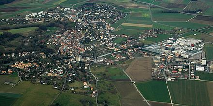 Aerial view of Orbe, showing the tree covered Orbe river and the hill of the old town Orbe-20061231.jpg